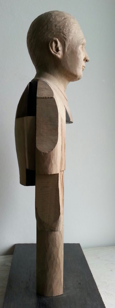 Smoking Man. Lime wood carving with paper and graphite by Lee Devonish, 2015.