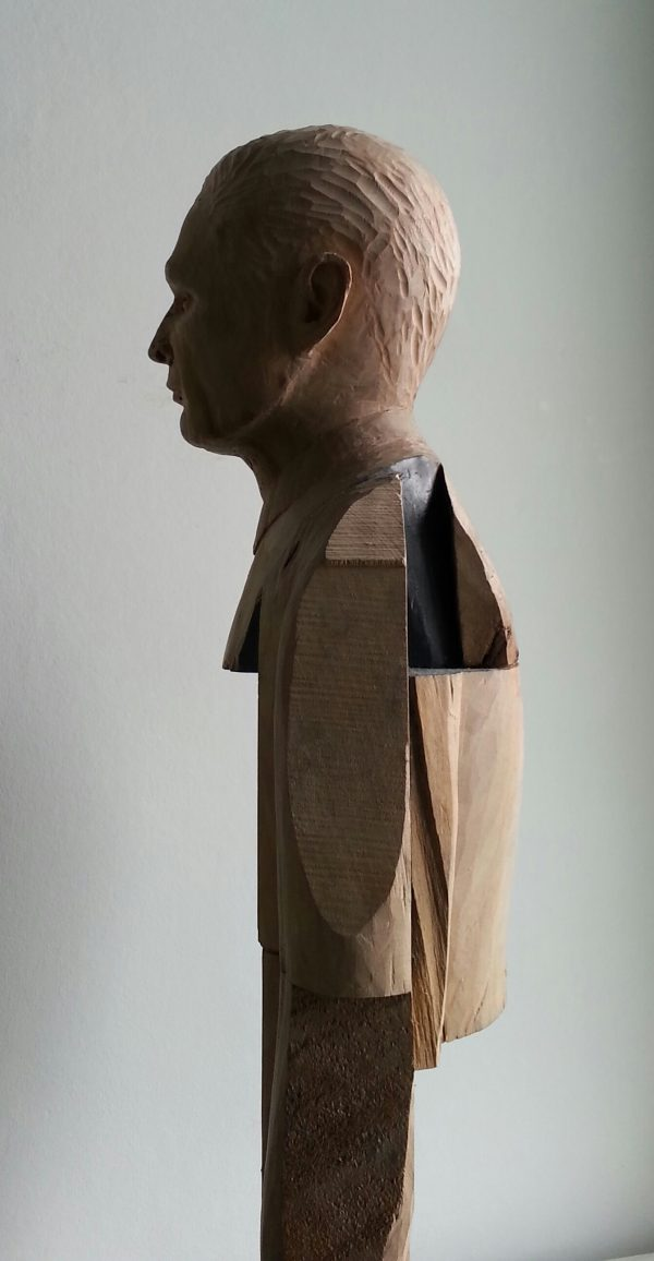 Smoking Man. Lime wood carving with paper and graphite by Lee Devonish, 2015