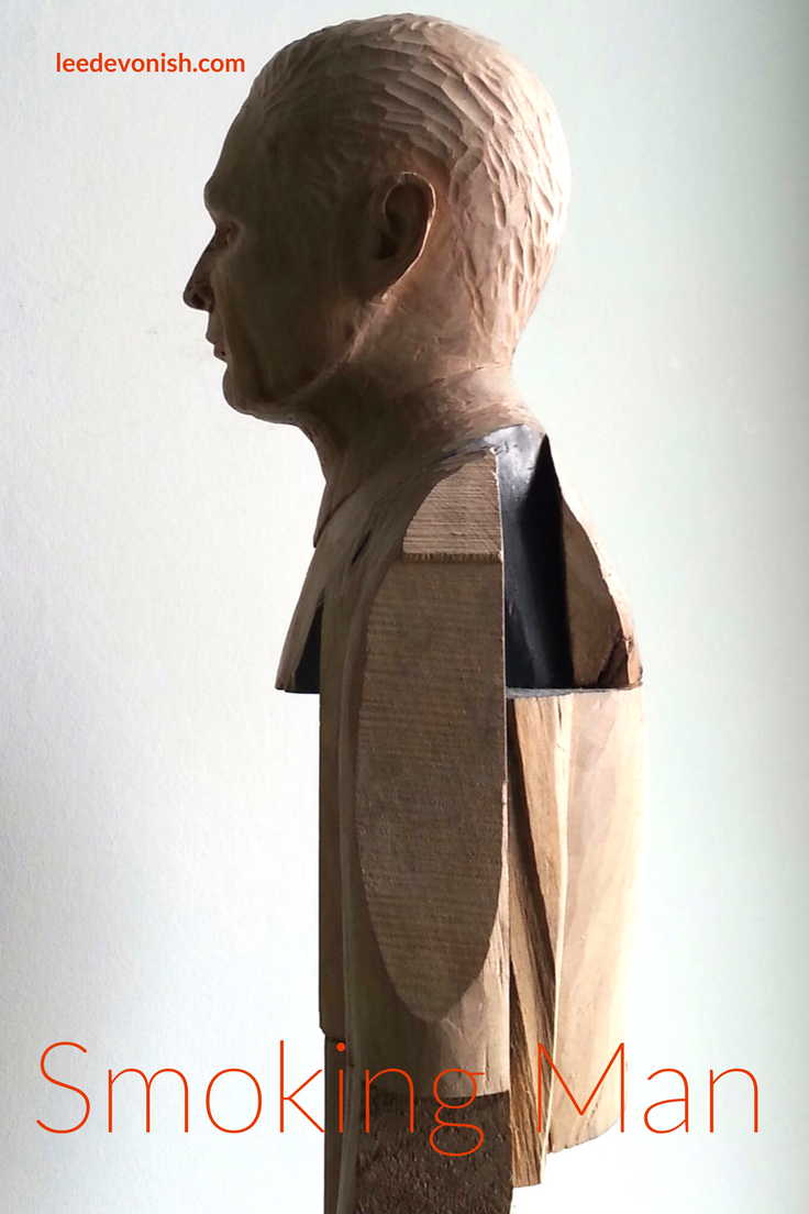 Read the story behind Smoking Man - Lime wood carving with paper and graphite, 2015. By Lancashire artist Lee Devonish.
