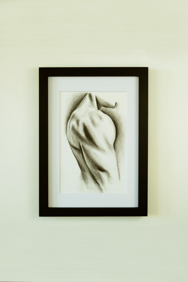Charcoal drawing of a man's deltoid