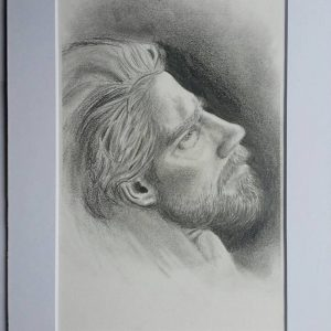 Upward, 2017. Upward is a pencil drawing of a bearded man, his head raised up towards a light source.
