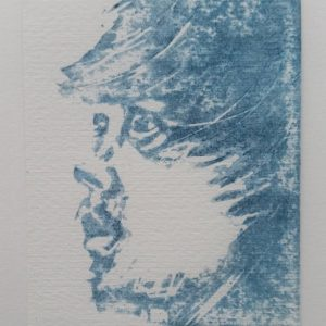 Wild Man (white) 2/10. Blue and white woodcut print of a man's 3/4 profile