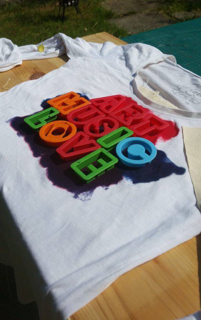 UV dye exposing in sunlight on white t shirt