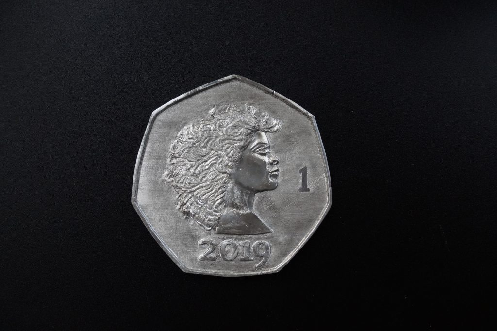 Pewter coin by Lee Devonish. Artist's Proof obverse