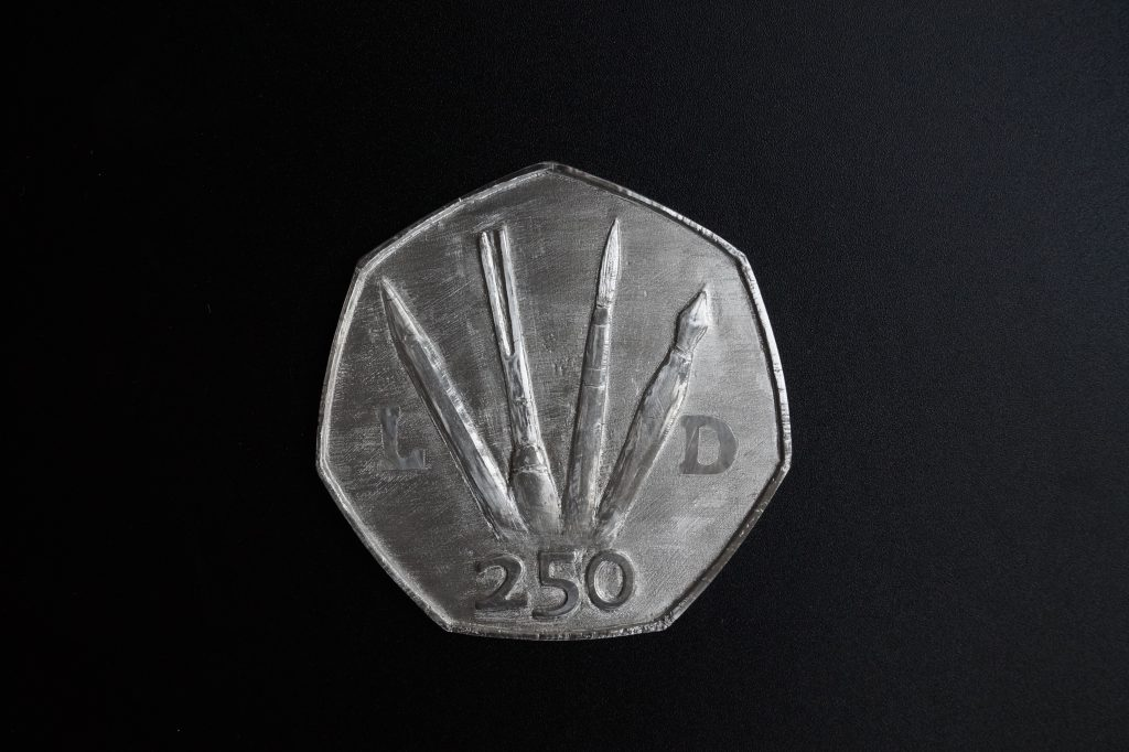 Pewter coin by Lee Devonish. Artist's Proof reverse.