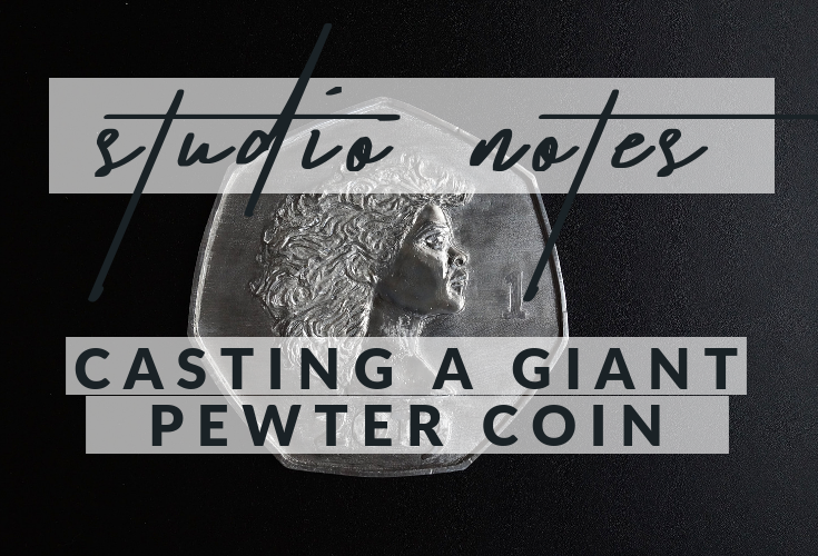 Casting a giant pewter coin.
