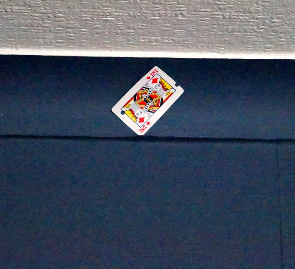 A playing card wedged in ceiling coving 11/01/19
