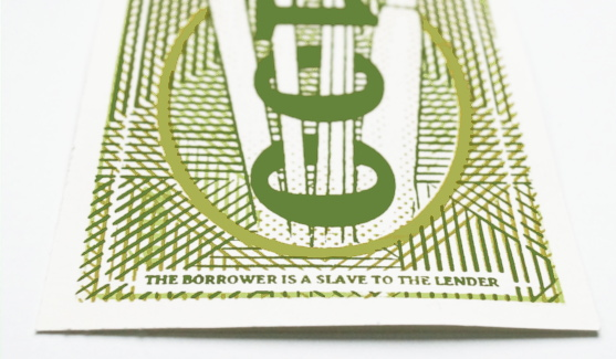 "Bottom of rear side of banknote saying: ""the borrower is a slave to the lender""."