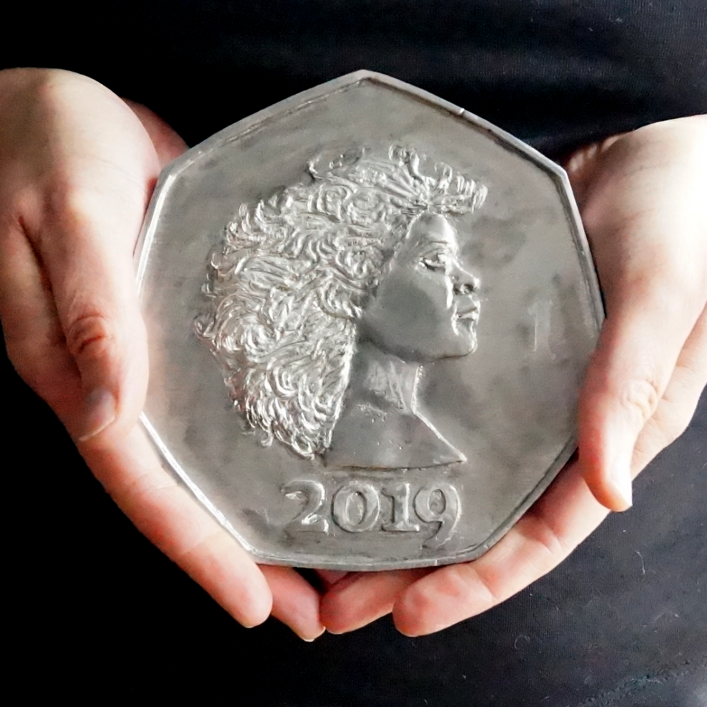 250, a large pewter coin by Lee Devonish