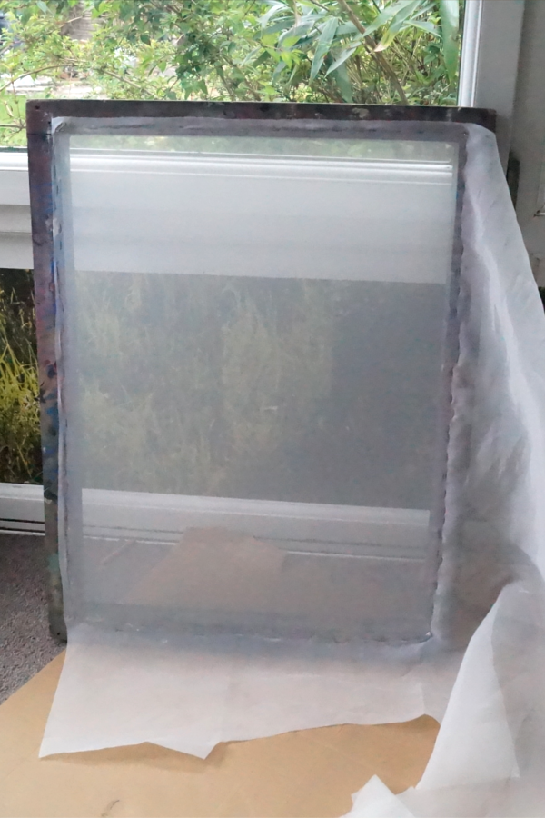 Stretching an aluminium screen with a wooden screen