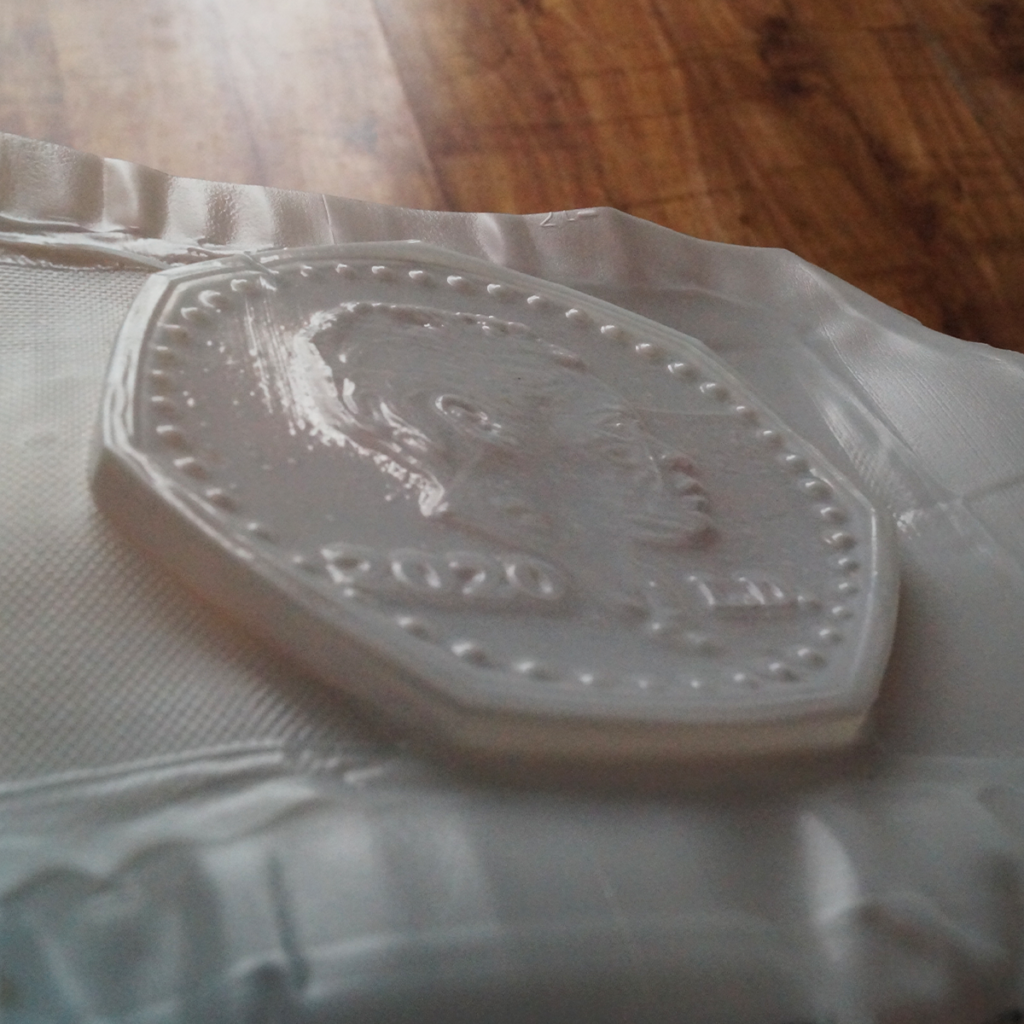 The 3d printed coin vacuum formed.