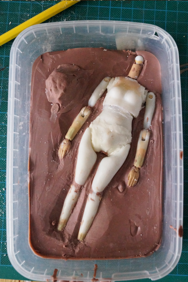 3D printed figure in clay bed for casting